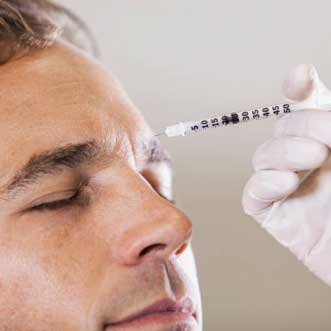 Man receiving an injectable botox at orthodontist office.